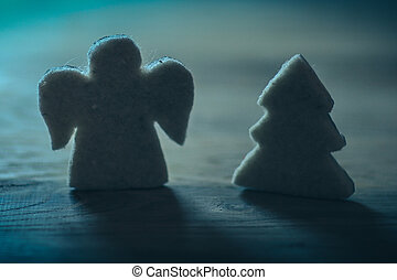 .gingerbread figures Christmas tree and an angel on the wooden