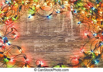 Vintage christmas background. Old Christmas garland on a wooden background. New Year background. Christmas decorations. Xmax background. Toned image.