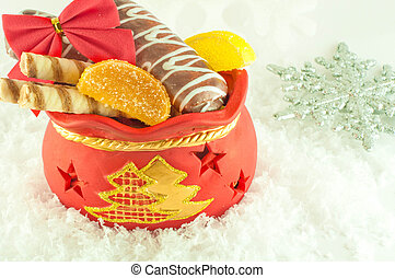 Christmas bag with gifts, cookies and fruit candy, a gift