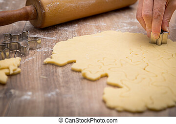 Christmas bakery with fresh cookie dough and biscuit cutter, rolling pin