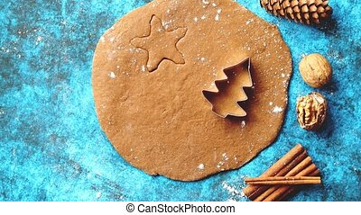 Christmas baking concept. Gingerbread dough with different cutter shapes