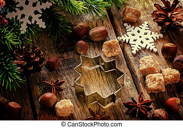 Christmas baking ingredients on a dark wood background....