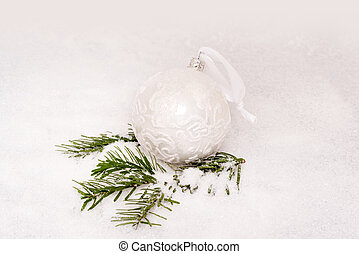 Christmas ball and fir branch with snow