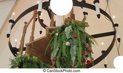 Christmas ball and hanging fern decorated in living room