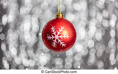 Christmas ball and snow in the night, abstract bokeh lights background