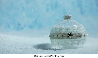 Christmas ball and snow - Merry Christmas and Happy New Year...