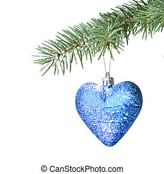 Christmas ball and snow on fir tree branch isolated on white