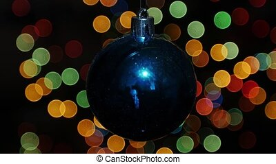 Christmas ball at background of blurred lights