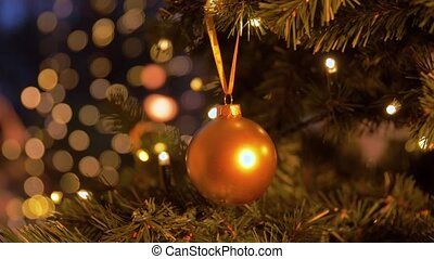 christmas ball decoration on artificial fir tree - holidays...