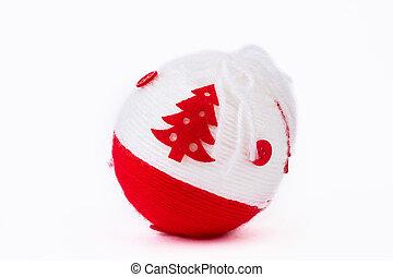 Christmas ball of yarn, white background.