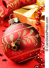 Christmas ball on festive background