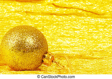 Christmas ball on golden background