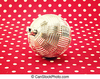 christmas ball on red polka dot with filter effect retro vintage style