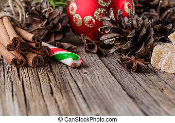 christmas ball on rustic table with cinnamon