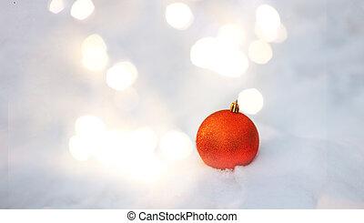 Christmas ball on snow.
