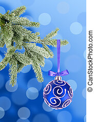 Christmas ball on the tree over blue background
