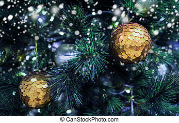 Christmas ball on xmas tree with snow in winter