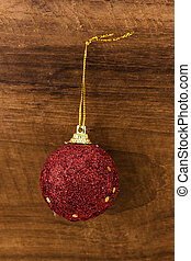 christmas ball red on wood background.