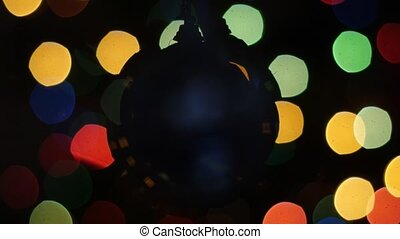 Christmas ball rotates at background of bokeh
