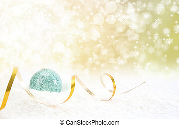 Christmas ball with ribbon on a glossy surface