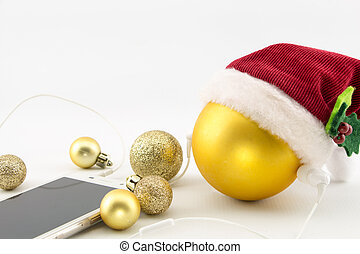 Christmas ball with Santa's hat and smartphone with earphones, isolated on white with copy-space