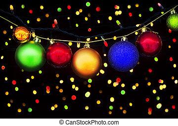 Christmas balls and lights on the Christmas background with bokeh