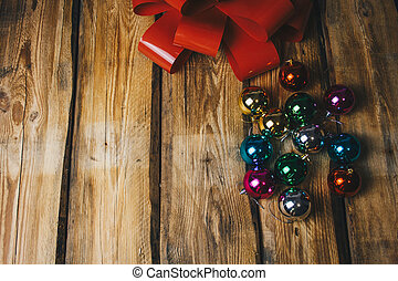 Christmas balls and red ribbon bow on Wooden Background, Decoration Balls with holiday ribbon
