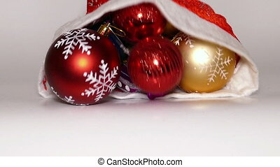 Christmas balls fall out of Santa Claus bag, slomo -...