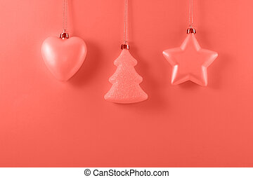 Christmas balls for decoration on a pink background.
