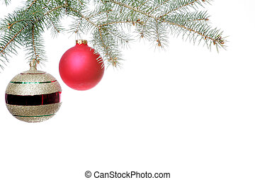 Christmas balls decorate pine bough.