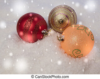 Christmas balls in the snow. New Year's background with falling snow