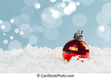 Christmas balls in the snow on a blue background with bokeh lights. happy new year card