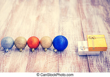 christmas balls isolated on a wooden background