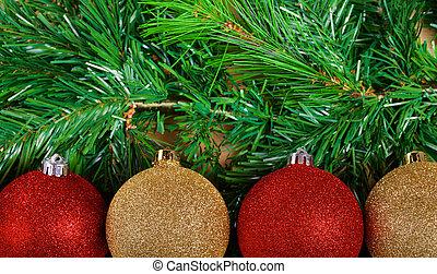 Christmas balls on green fir-tree branches