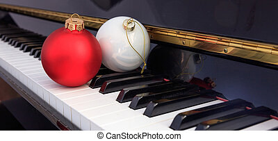 Christmas balls on piano keyboard