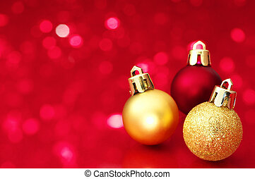 Christmas balls on red defocused lights background.