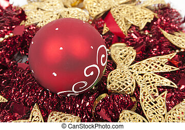 Christmas balls on red tinsels like a background.