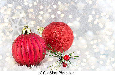 Christmas balls on shiny silver background
