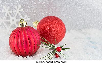 Christmas balls on shiny silver background