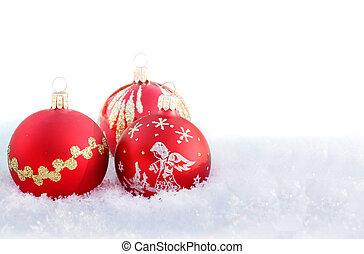 christmas balls on white snow