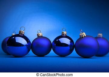 Christmas balls - Photo of blue Christmas balls on a blue...