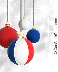 Christmas balls with French flag in front of lights background