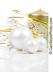Christmas balls with golden candle, on a white background