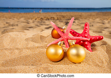 christmas balls with starfish on beach