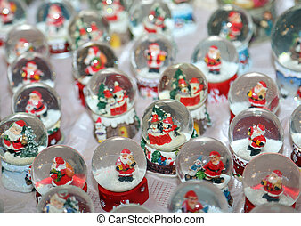 Christmas balls with water inside and Santa Claus as...