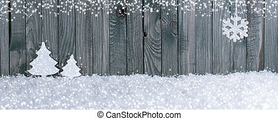 Christmas banner with fir trees, snowflake and snowdrifts on wooden planks background
