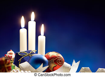 christmas bauble and candle light, blue background