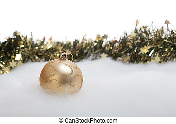 Christmas bauble and garland in snow