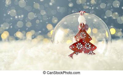 Christmas bauble with a red Christmas tree on snow