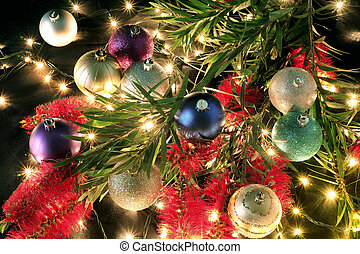 Christmas Baubles and Bottlebrush on Black Background